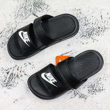 5a28e41544607 Nike Benassi Duo Ultra Black White Slide Sandal Slipper - Best D