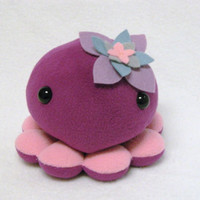 Plush octopus toy with flower