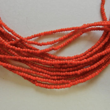 """28"""" Strand Of Drawn, Cut, Irregular Brilliant Red Orange Bohemian Made African Trade Seed Beads Sold Per Strand"""