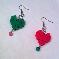 Mix and match pixel heart earrings in pink and green