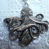 Silver octopus steampunk necklace, Octopus has collection of tiny watch gears, hands, wheels and stems encased in resin.