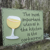 "Hand Painted Wooden Green Funny Wine Sign, ""The most important utensil in the kitchen is the corkscrew."""