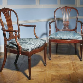 A pair of George III carved mahogany open armchairs, circa 1770, attributed to John Linnell | lot | Sotheby's