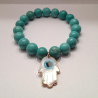 Turquoise with Mother of Pearl Hamsa Pendant   orianalamarca