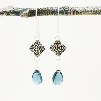 London blue topaz earrings. Sterling silver dangle earrings with london blue topaz briolette. Modern, unique, handmade December birthstone