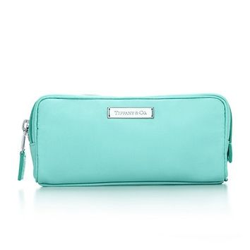 Tiffany & Co. -  Cosmetic bag in Tiffany Blue® nylon. More colors available.