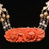 Art Deco Celluloid Necklace Pendant Carved Faux Coral Roses Relief Brass Circa 1920s  Antique Jewelry Heirloom Bows Medallions Beads Beaded