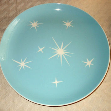 Six Harkerware Star-Lite place settings, olympic-white stars, light teal background, atomic retro pattern.