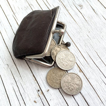 Tiny purse filled with 6 silver sixpences. Tiny weeny little brown leather purse, the vintage sixpences five are 1950s and one 1963.
