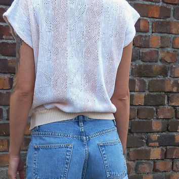 peaches and cream knitted top . vertical stripe. made in the u k . short sleeves  . holey . mesh knit