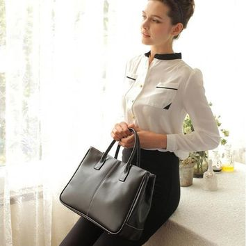 Leather  tote / bag with interior compartments