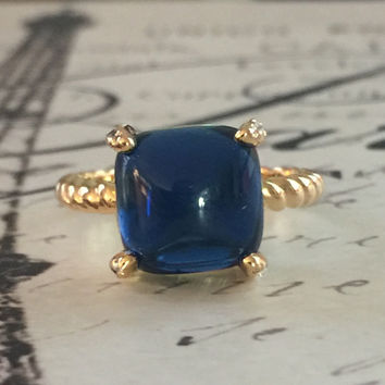 A Perfect 18K Gold 4CT Cabochon Dark Montana Blue Sapphire Ring