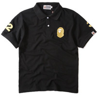 BAPE Gold Embroidered '32 Polo Shirt