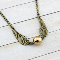 Harry potter necklace,wing necklace,golden snitch necklace,bronze Wings,Champagne Gold Pearl. Magic. ,friendship christmas gift