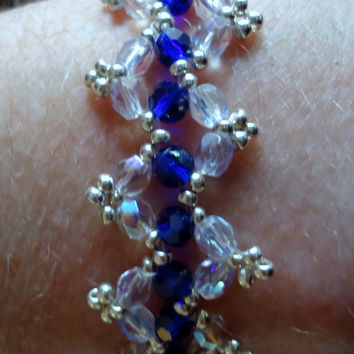 Beaded bracelet in zig zag pattern with blue rondells, clear crystals and silver Miyuki seed beads. Handmade