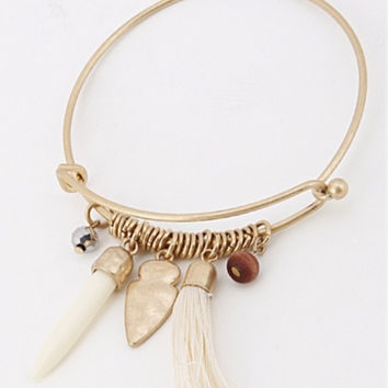 This Must have Bracelet ivory tusk arrowhead tassel gold