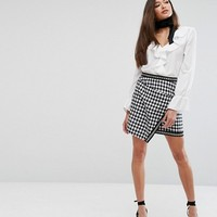PrettyLittleThing Houndstooth Wrap Mini Skirt at asos.com