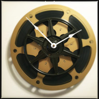 """Wall Clock made from Recycled 10.5"""" Gold Film Reel layered behind 7"""" Black Film Reel/Perfect Media Screening Room/Great Housewarming Gift"""