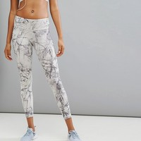 Reebok Training Lux Bold Marble Print Tight at asos.com