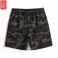 Summer Men's beach shorts sexy liner plavky trunks fitness board suit joggers swimwear elastic surf praia mesh swimming trunks