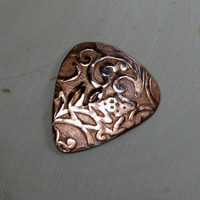 Rococo copper guitar pick with asymmetrical vine design