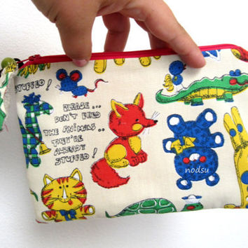 Zippered pouch from vintage fabric featuring animals, pink lining, stuffed animal zipper pull, linen pouch