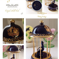 Limoges France cobalt blue caged bird figurine with gold courting scene