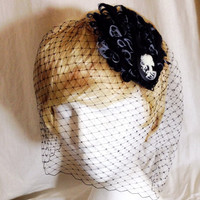Two part black birdcage veil and skull lady cameo feather fascinator