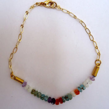 Multi gemstone bracelet with gold plated chain and gold plated lobster claw clasp.