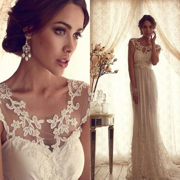 Vintage Sheer Wedding Dress Backless Lace Beach Wedding Dress Empire Covered Buttons A Line Wedding Dress With Short Sleeves