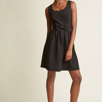 Scalloped Pleated A-Line Dress in Black