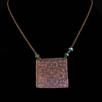 Handmade square mandala necklace. Etched, hammered copper, antiqued, with green crystals and chain