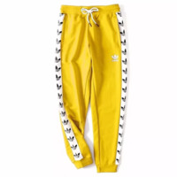 Adidas Fashion new string mark print leisure sports loose women and men pants Yellow