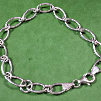 Vintage Chain Bracelet 7.75 Inch Long Oval Shaped Links Marked 925 Italy Lobster Clasp 6 mm Wide Chain Wear As Is or Add Charms to the Chain