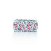 Tiffany & Co. - Tiffany Cobblestone wide band ring in platinum with pink sapphires.