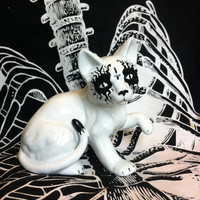 Death metal ceramic cat with inverted cross