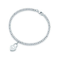 Tiffany & Co. - Return to Tiffany™ mini heart lock in sterling silver on a bead bracelet.