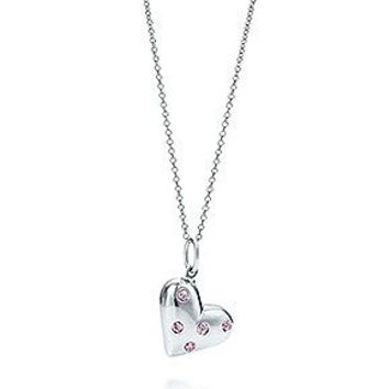 Tiffany & Co. -  Etoile heart charm with pink sapphires in sterling silver on a chain.