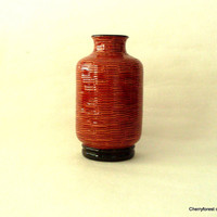 Vintage ceramic vase by Bitossi  with a wicker weave effect.