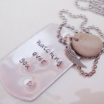 Watching over you unisex hand stamped dog tag necklace with angel wing and beach stone
