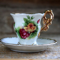 Enesco miniature teacup and saucer : floral roses with gold