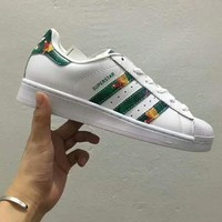VLXZRBC Adidas superstar shell sports shoes white-green gold line H-PSXY
