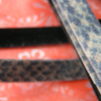 Snakeskin Look, Fuzzy Ribbon with sponge like backing. Unfinished edge, however it does not fray due to the backing on the reverse side.