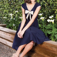 1940's Style STOP STARING Navy Blue Belinda Swing Dress With Tan Bow - Unique Vintage - Cocktail, Pinup, Holiday & Prom Dresses.