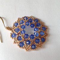 handmade round beadwoven earrings of shappire Swarovski bicones of 4 mm and gold seed beads