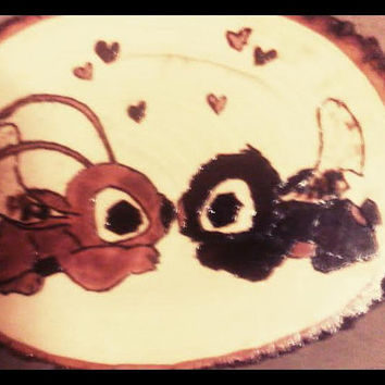 Alien Plaque exhibiting True Love with their loving nose kisses on natural wood base
