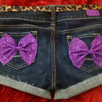 Low rise denim shorts with Purple sequin bows by AngeliqueMerici