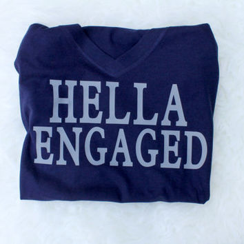 Hella engaged t shirt with gray writing