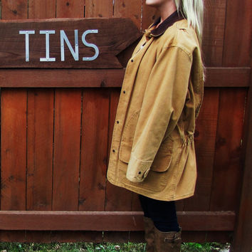 vintage Woolrich blanket lined cotton canvas barn field duck coat.made in USA. rustic saddle tan canvas blanket lined work coat