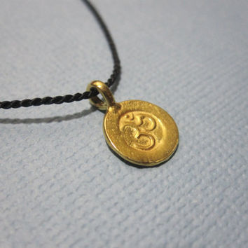 Silk String Sanskrit Om Wish Necklace by MarisaLeeDesigns on Etsy